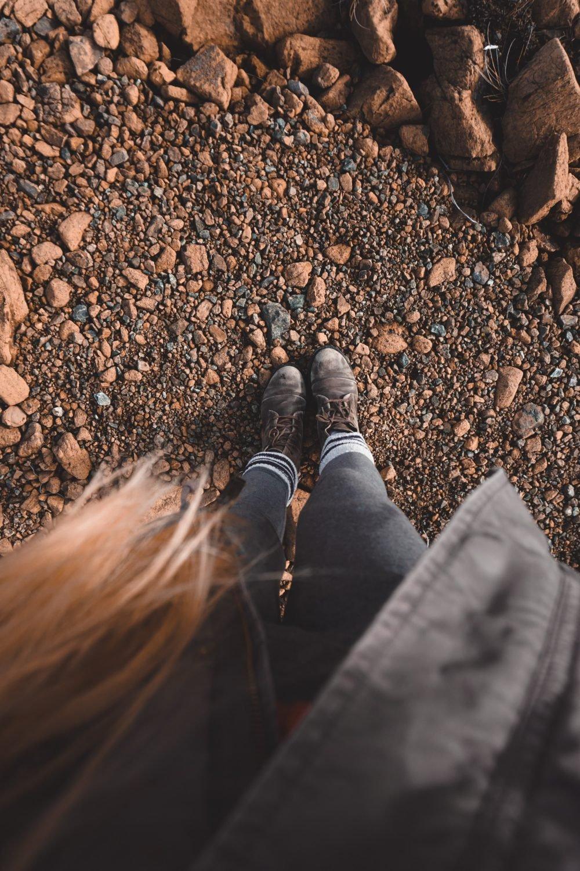 Hiking on Earth's Mantle: The Tablelands in Gros Morne National Park, Newfoundland and Labrador, Canada #adventure #tablelands #canada #outdooraesthetic www.bucketlistbri.com BUCKETLIST BRI