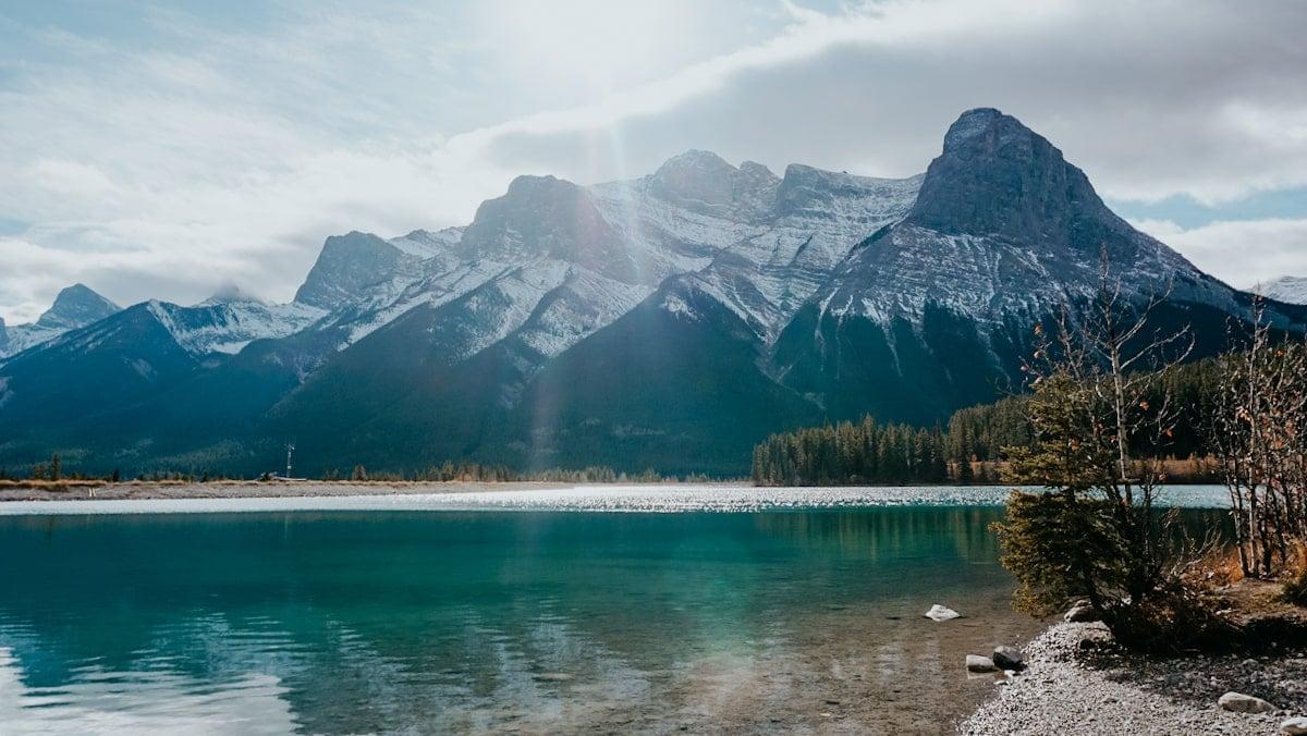 snowy mountain rake turquoise lake alberta canada road trip