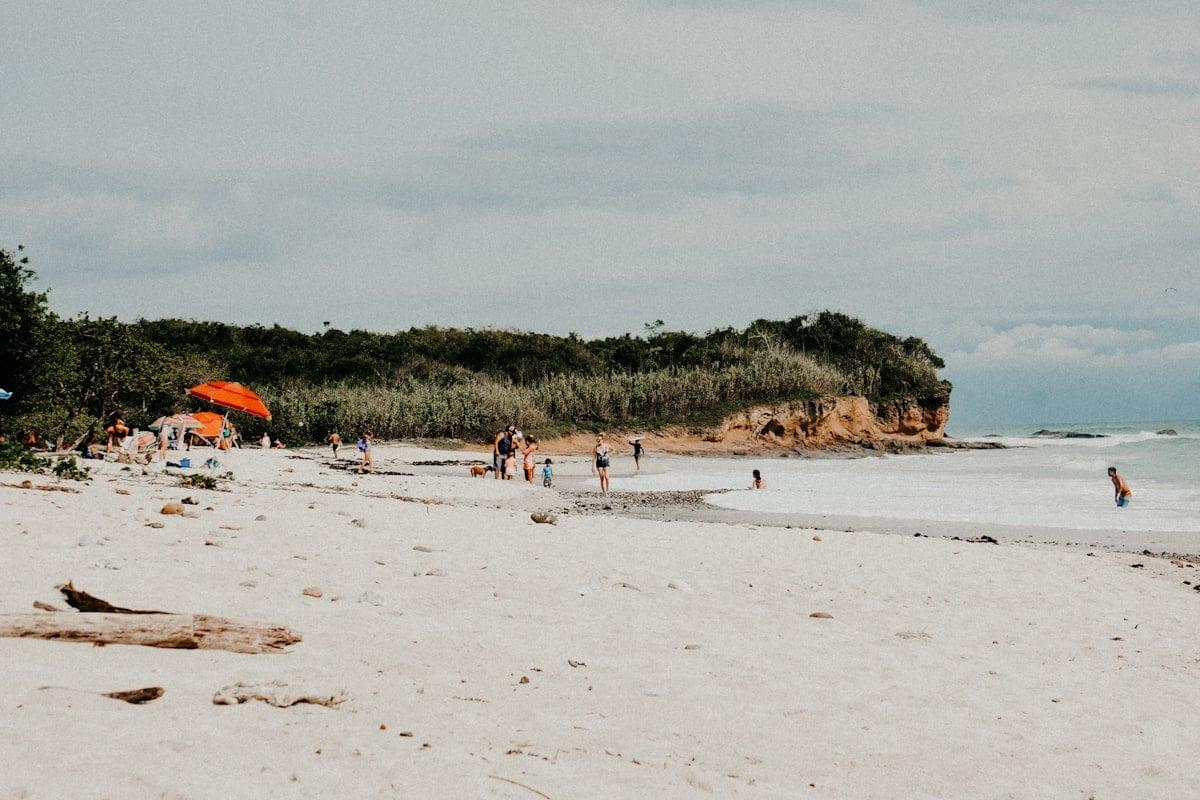 playa la lancha with people and umbrellas