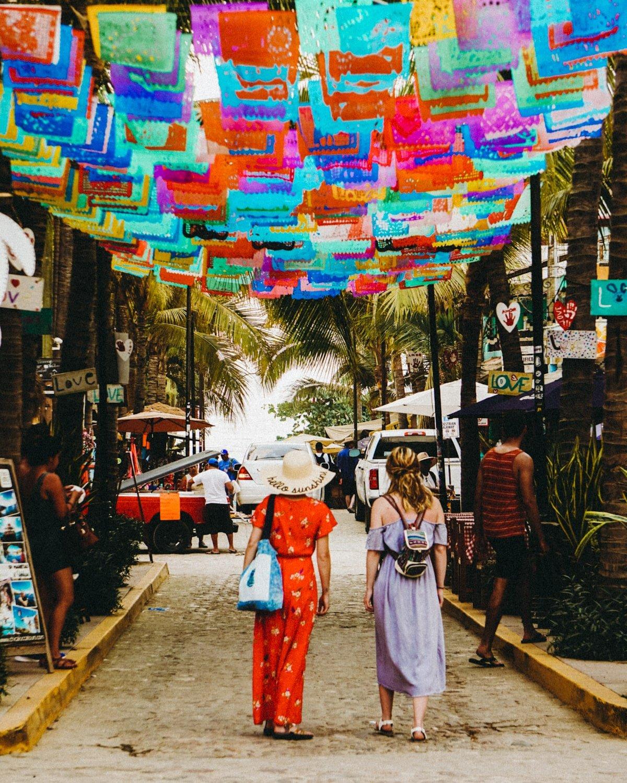 colorful flag street in sayulita mexico