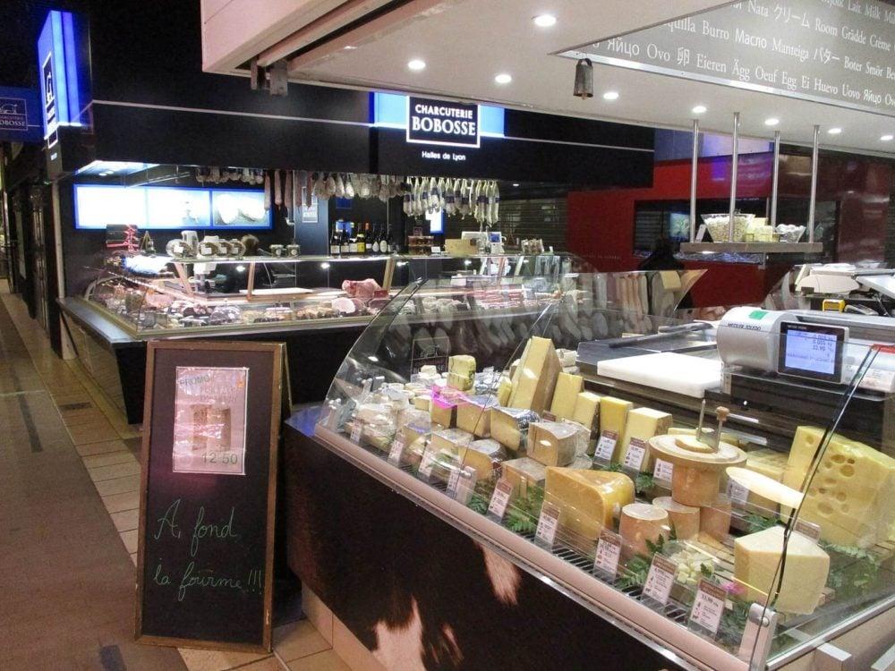 les halles de lyon paul bocuse | cheese stalls