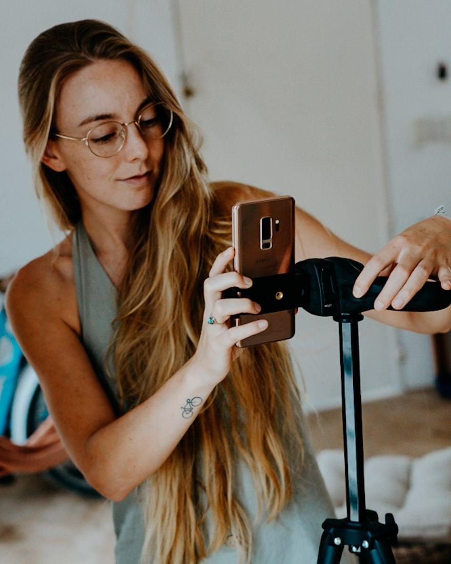 girl vlogging with travel blogging gear | tripod