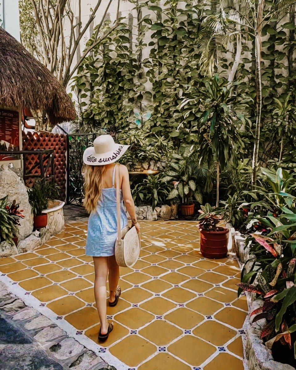 woman in courtyard garden in playa del carmen