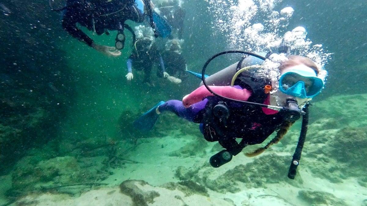 girl diving in casa cenote