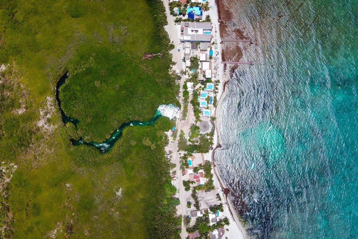 drone image of casa cenote mexico