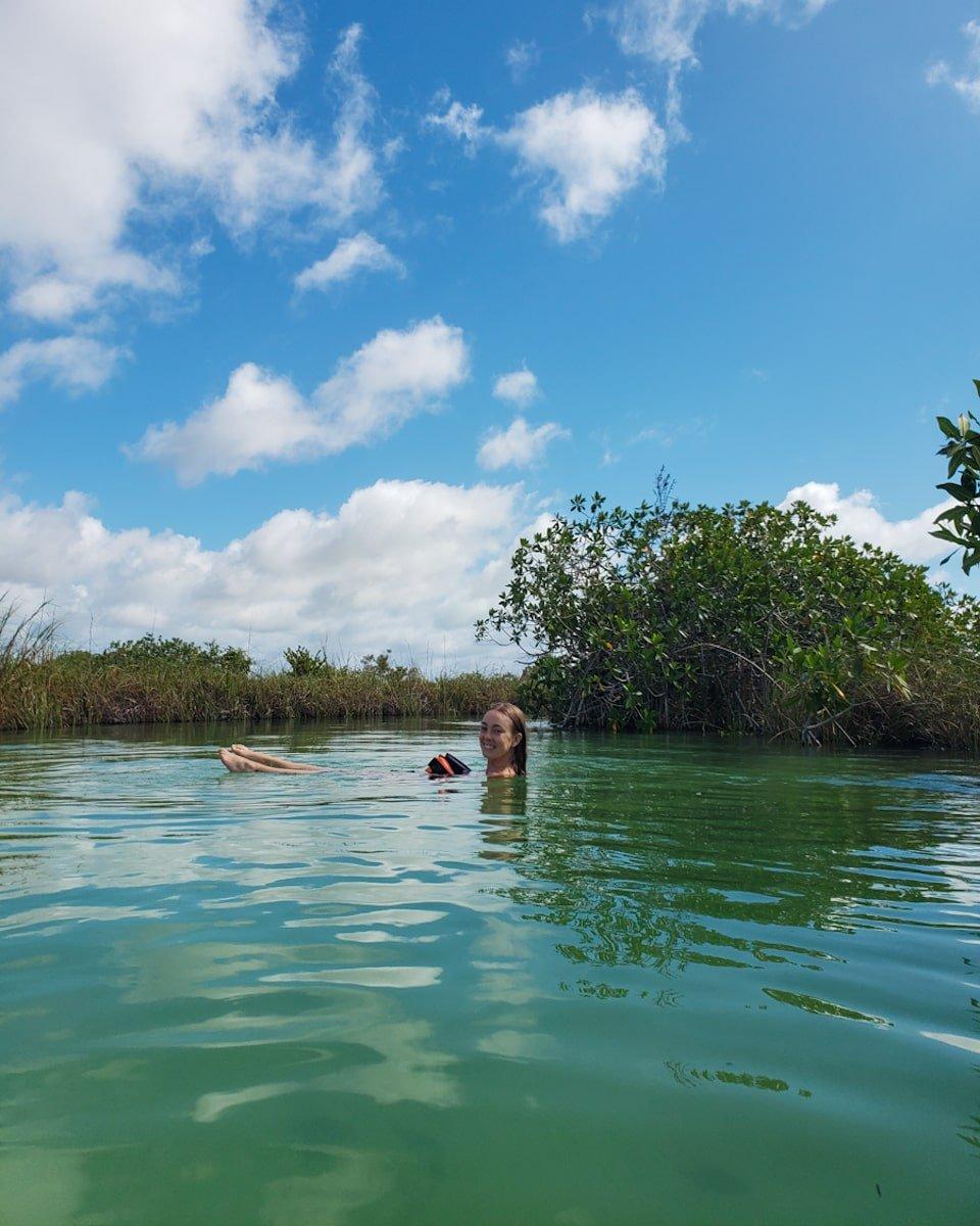 woman floating down sian ka'an mayan canal