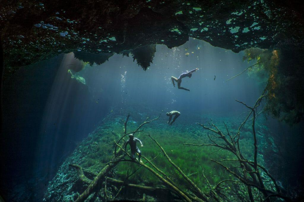 freedivers in cenote carwash