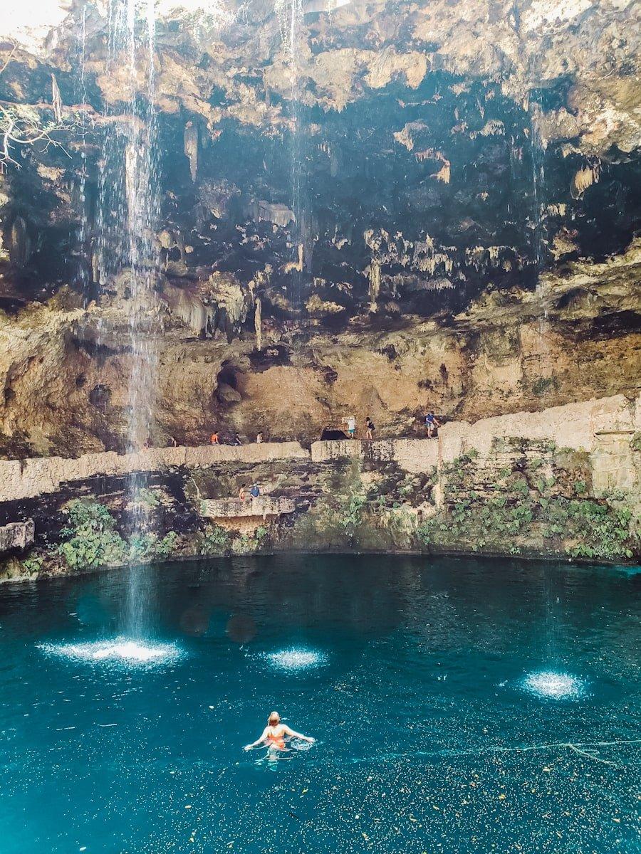 woman swimming in cenote zaci in valladolid