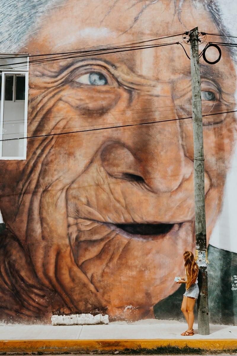 """""""El Parajito"""" old mayan man mural in Tulum"""