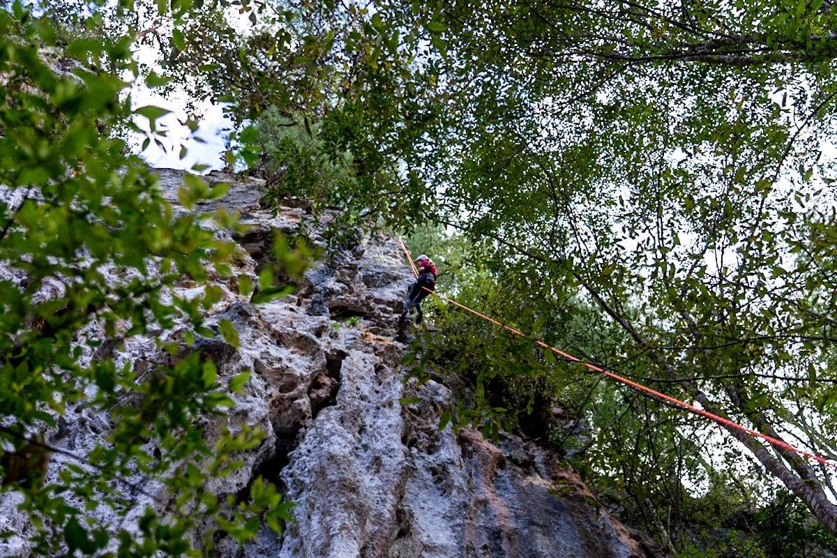 woman rock climbing in el arcotete ecotourism park