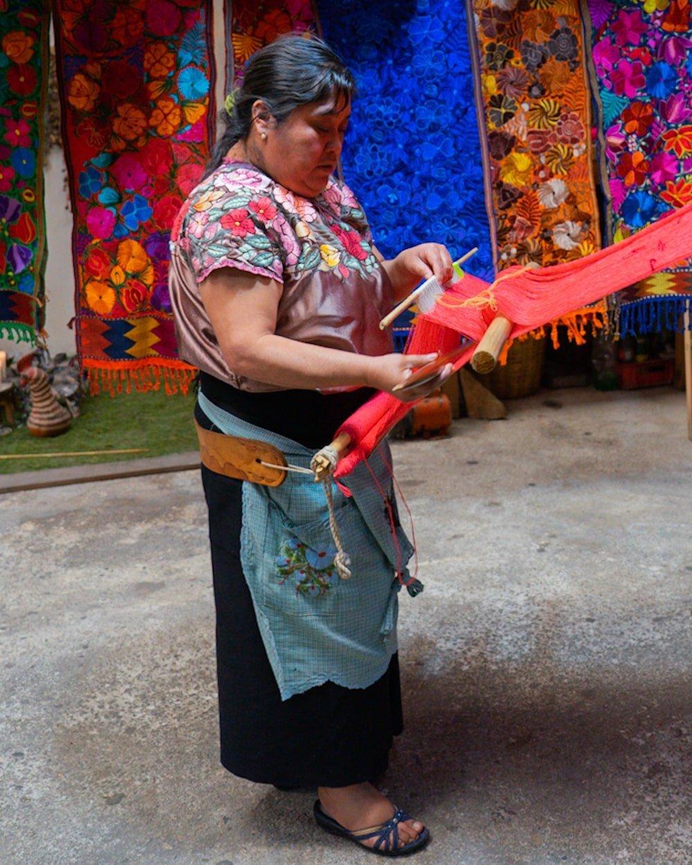 Zinacantan woman weaving with backstrap loom technique