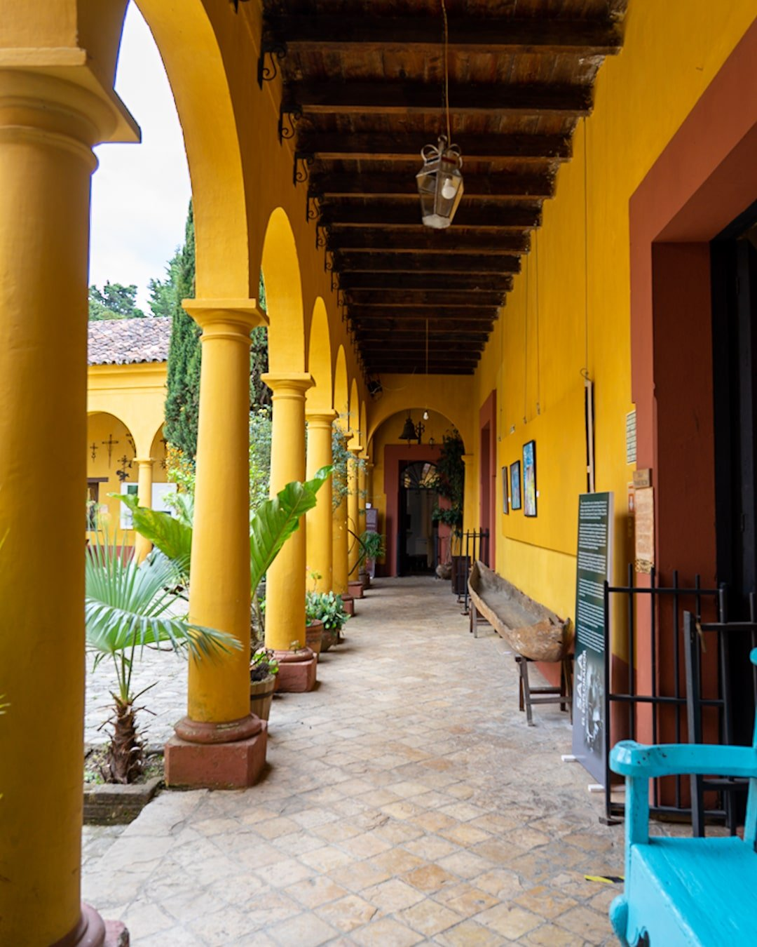 yellow pillars lining the na bolom museum outdoor hallway