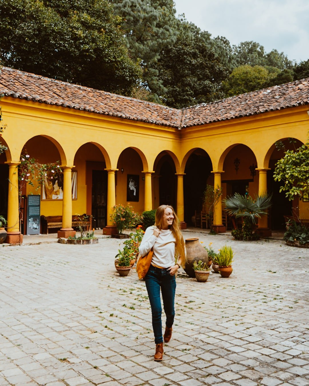 woman in Na Bolom Museum courtyard