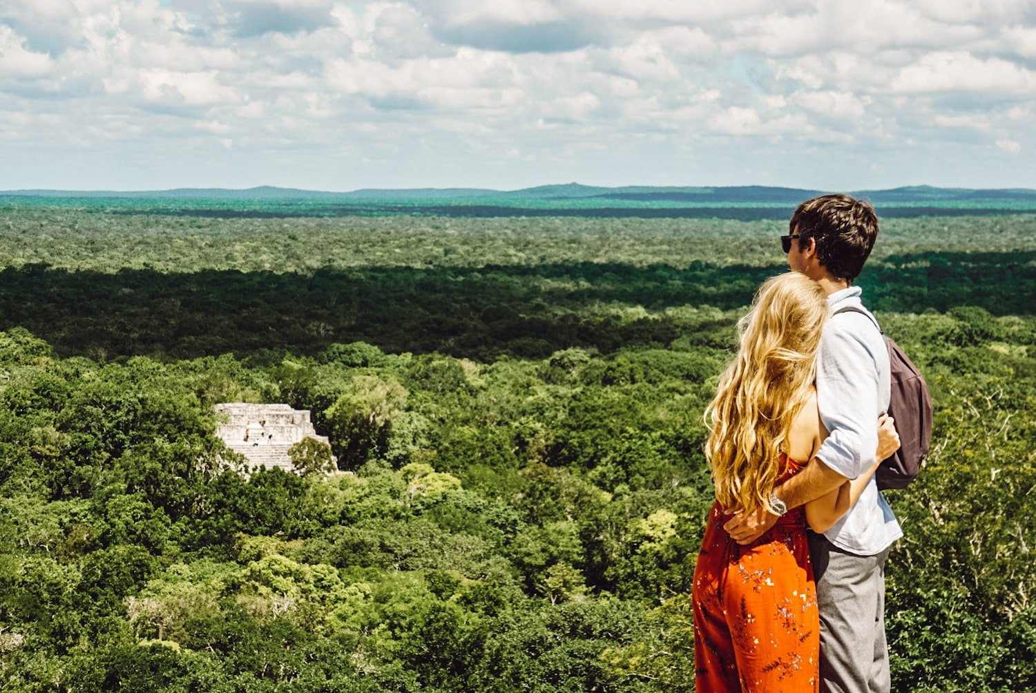 couple overlooking Calakmul mayan ruins in Campeche, Mexico