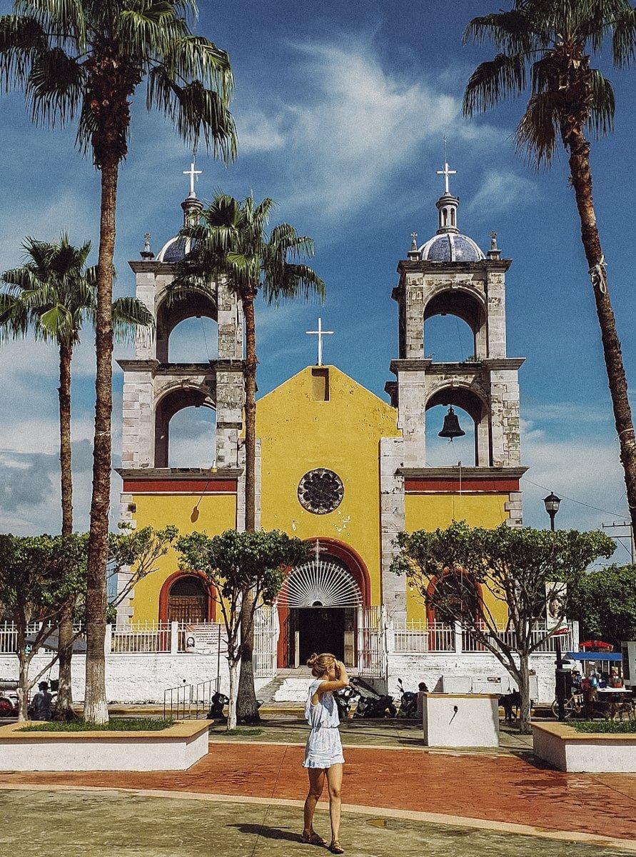 girl standing in san blas plaza in nayarit mexico