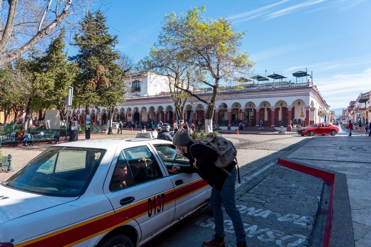 man hailing taxi in san cristobal de las casas mexico