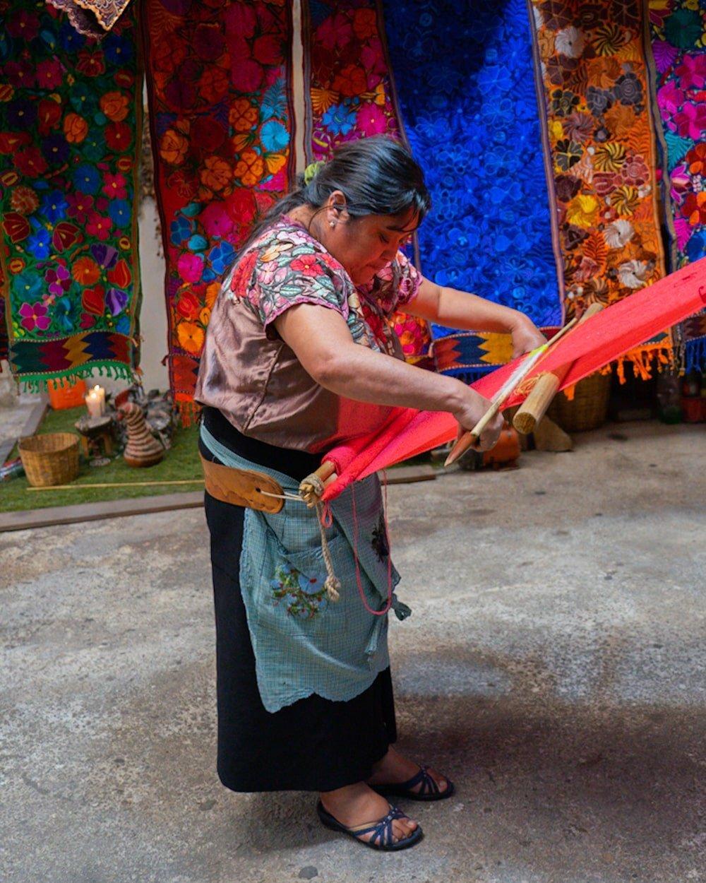 Tzotzil maya woman weaving with backstrap loom