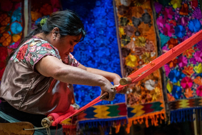 Indigenous woman weaving with backstrap loom in Zinacantan Chiapas Mexico