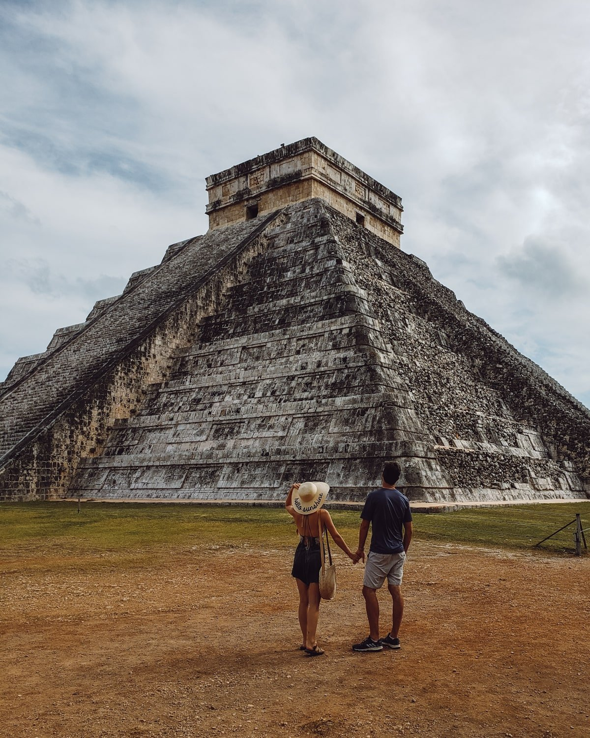 couple in front of Chichen Itza ruins in Mexico