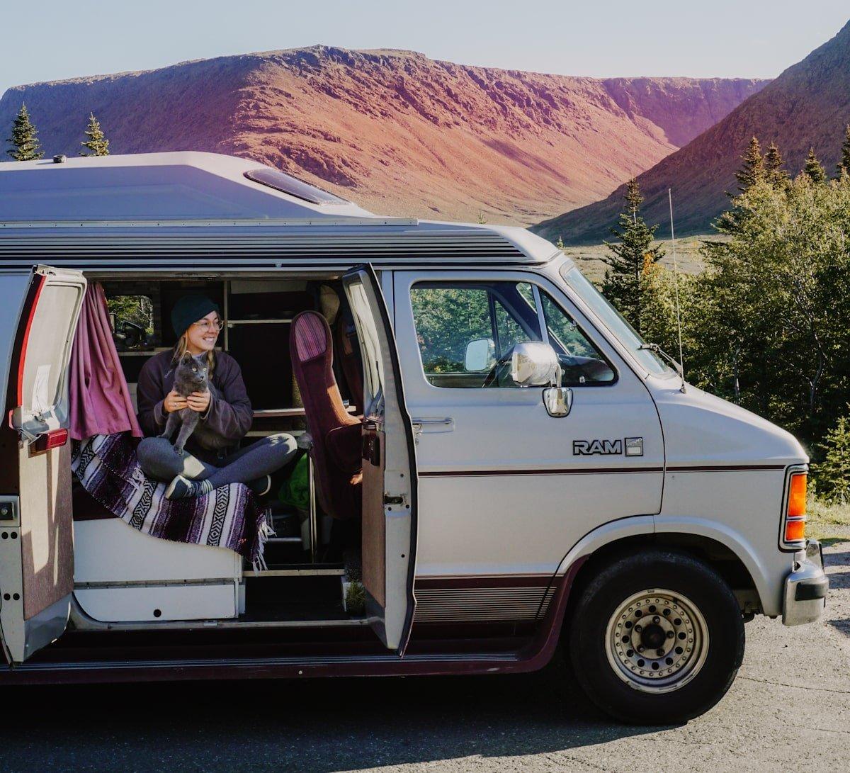 girl and cat in roadtrek van | digital nomad life