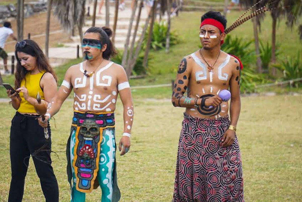 mayan dancers inside tulum ruins