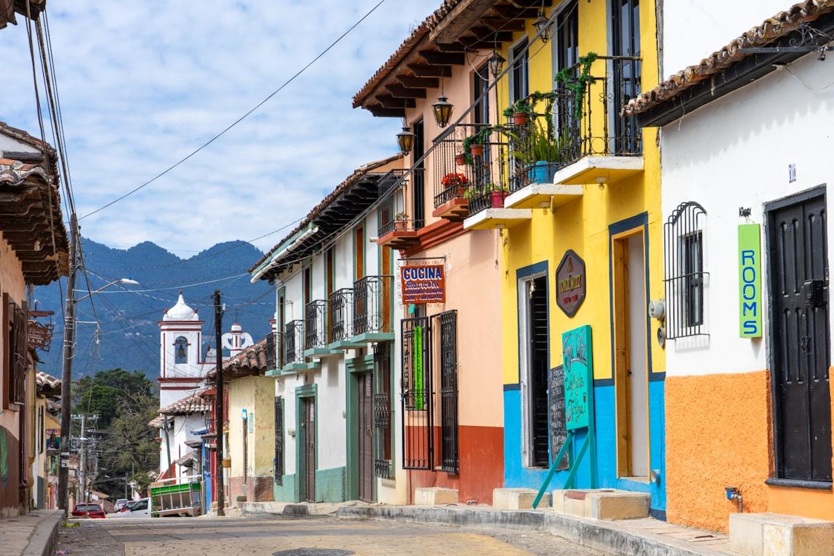 colorful street with church in san cristobal de las casas, chiapas mexico
