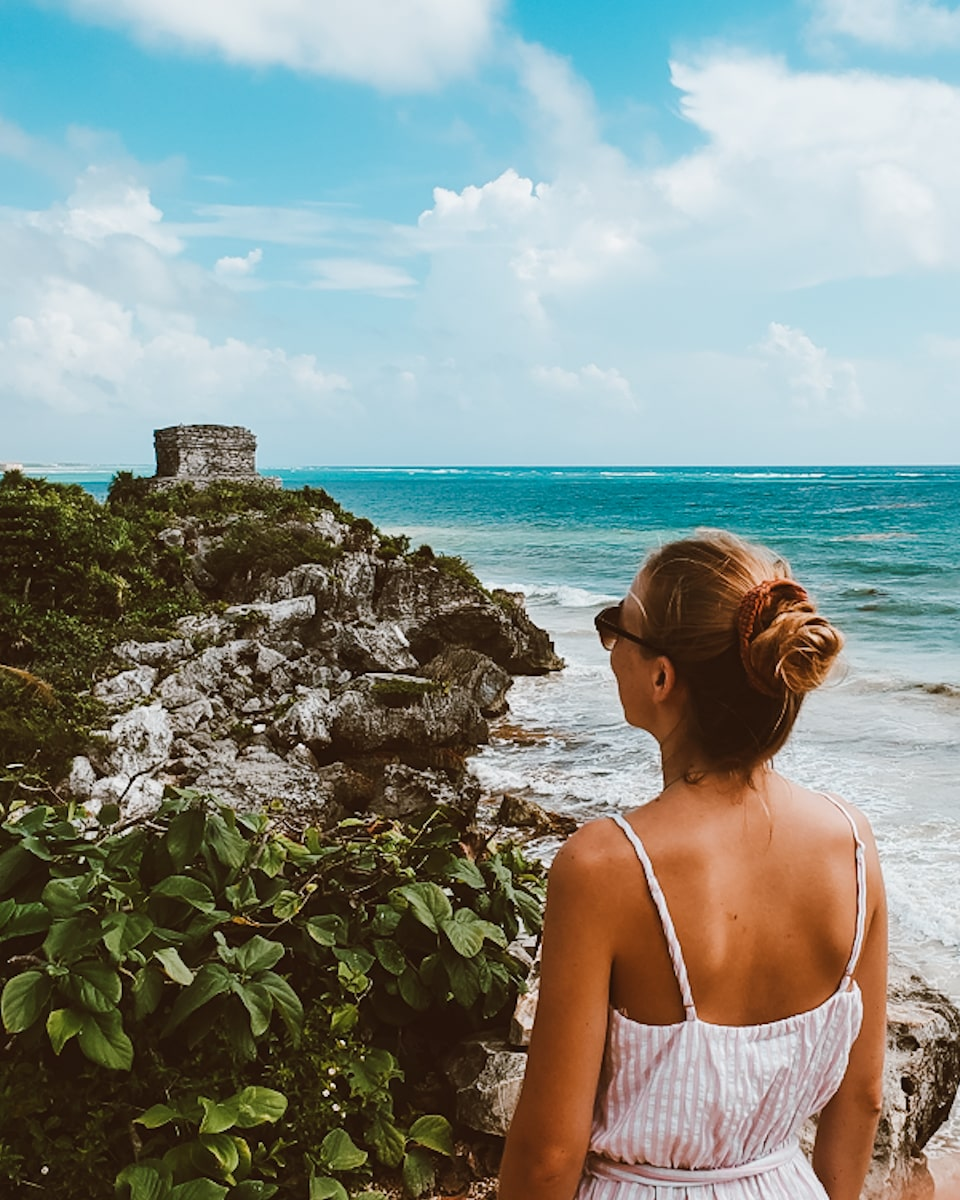 tulum ruins instagram spot in front of temple of the wind god