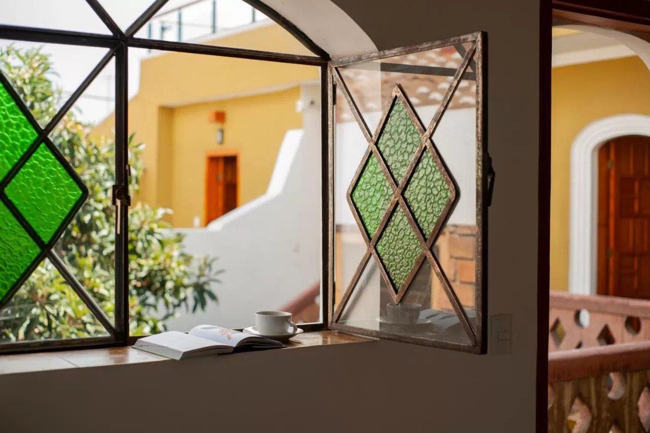 casa cafeologo hotel window with coffee mug and book on window sill
