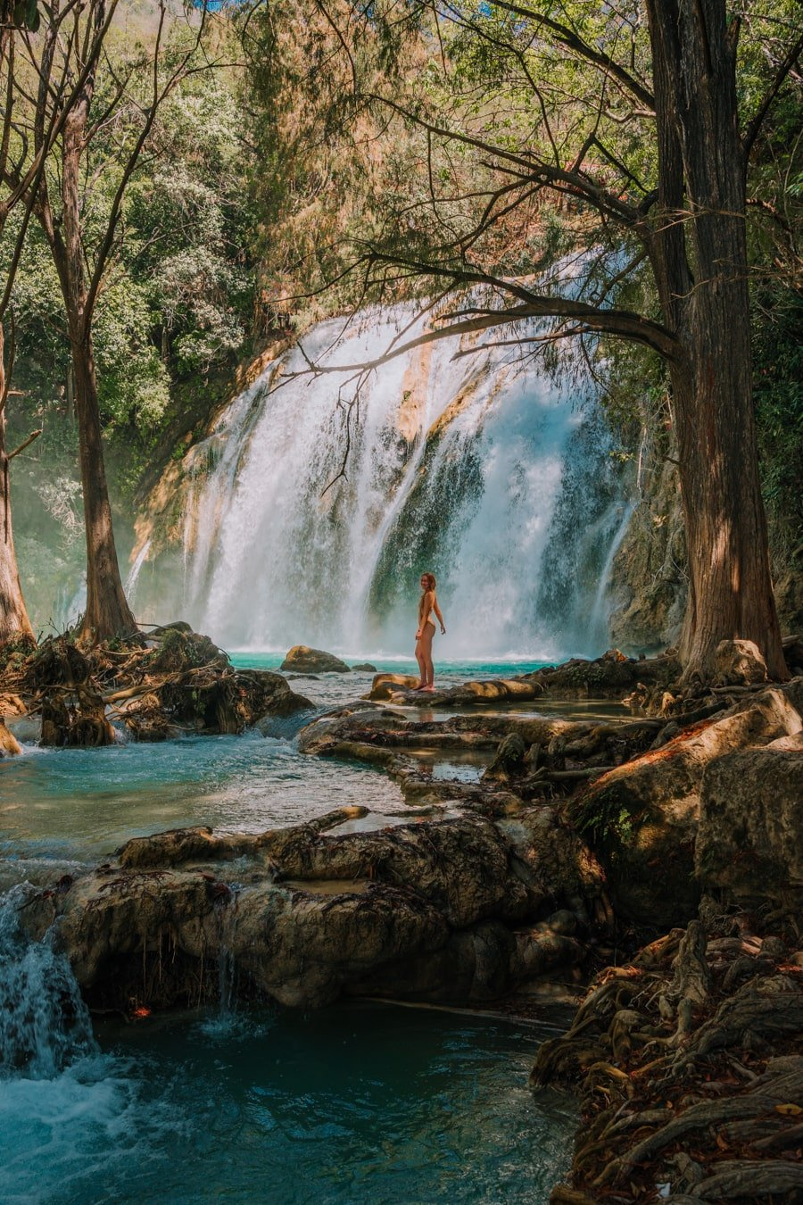 girl standing in Cascada Ala de Angel in El Chiflon in Chiapas Mexico