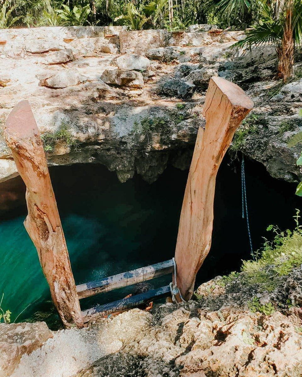wooden ladder cenote calavera main entrance in tulum mexico