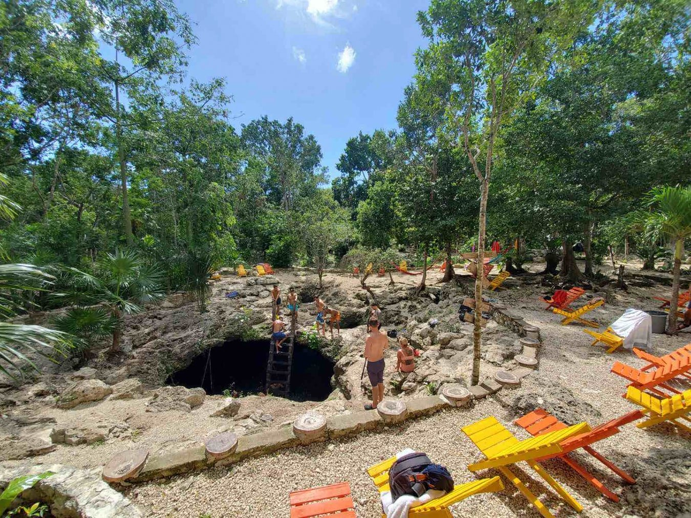 cenote calavera main entrance with lounge chairs and people