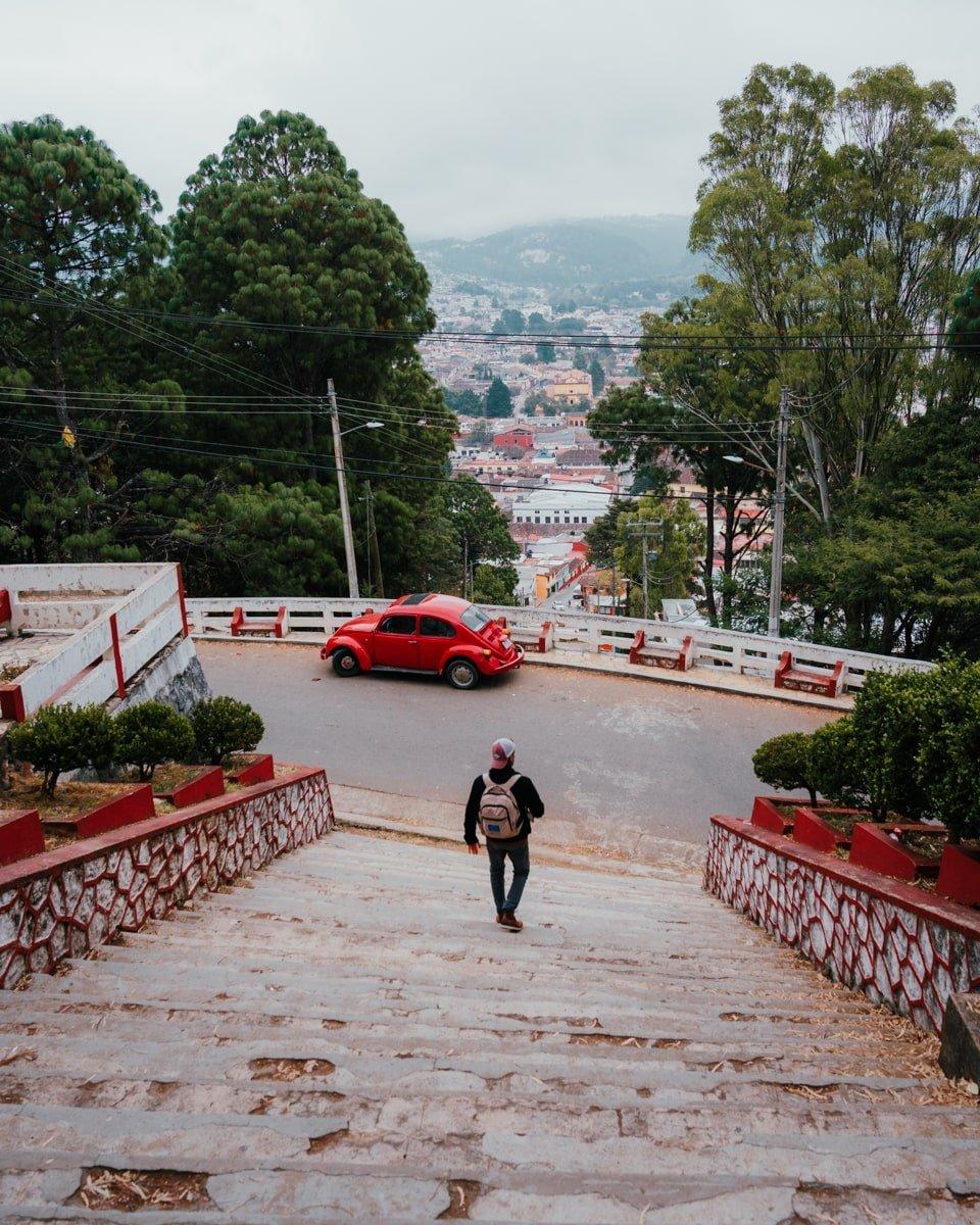 man walking down steps on cerro de san cristobalito