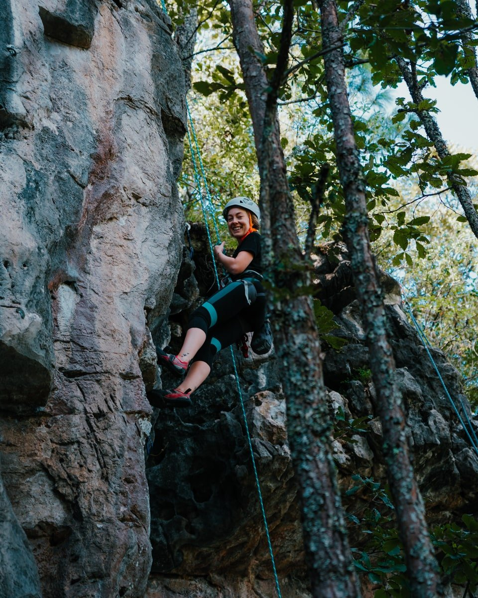 woman rock climbing at cerro don lauro mountain