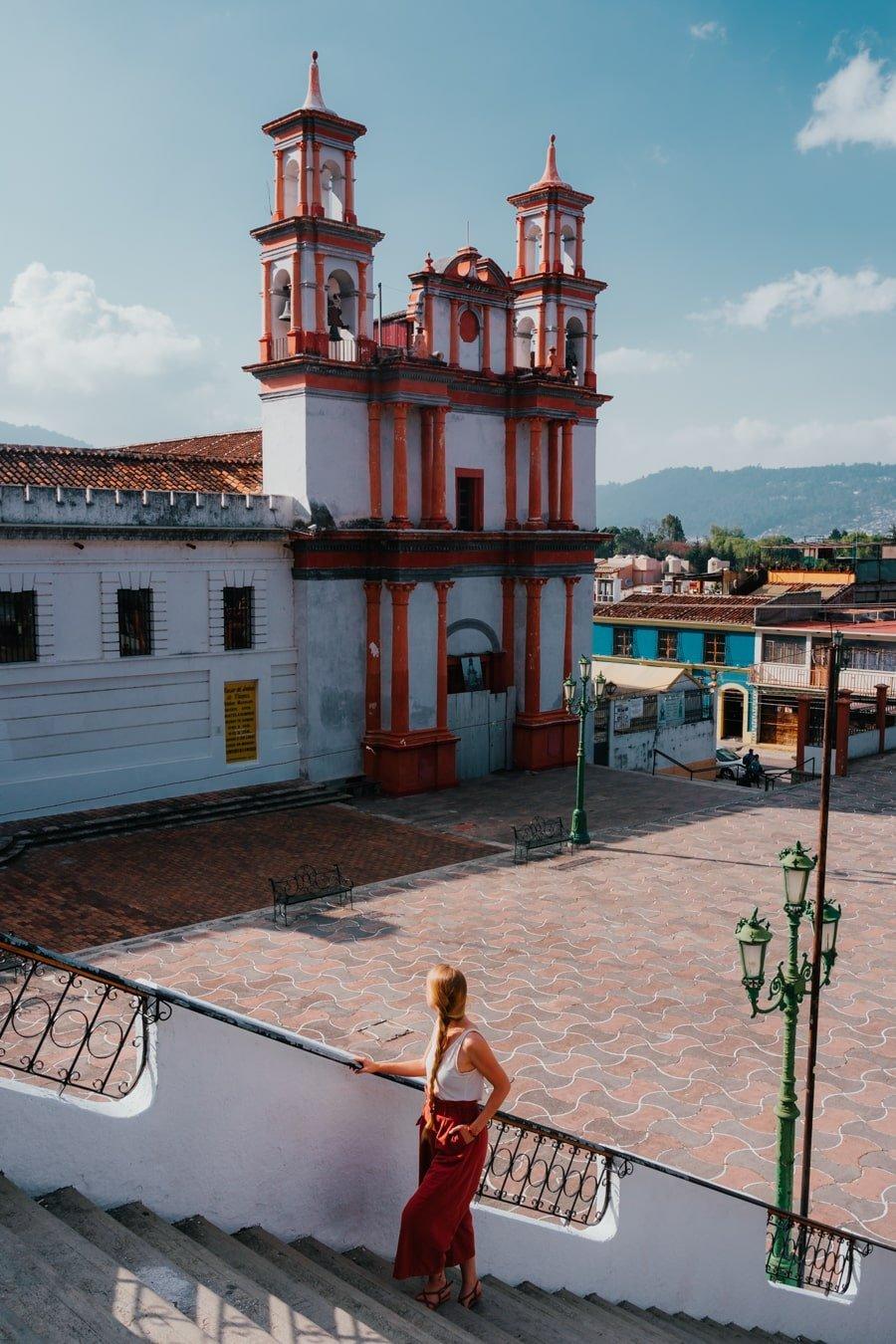 woman on stairs at ex-covento de la Merced church in san cristobal de las casas chiapas mexico