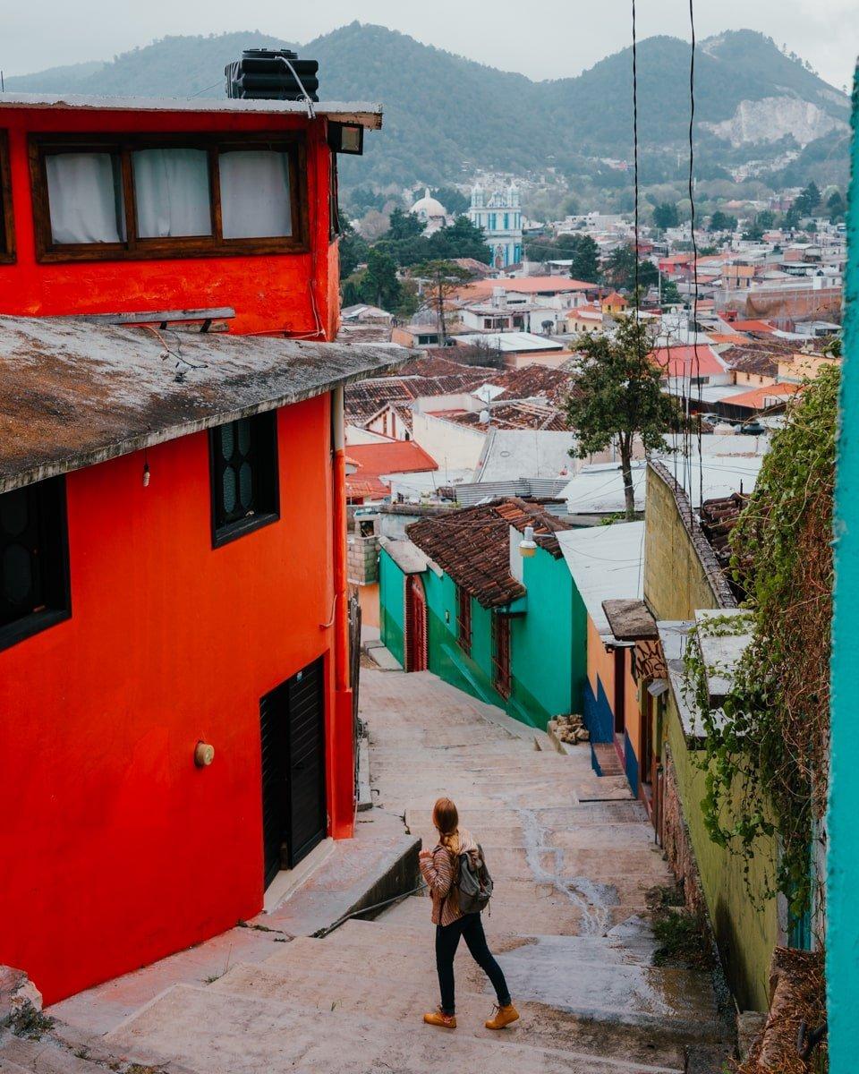 woman on stairs overlooking san cristobal city