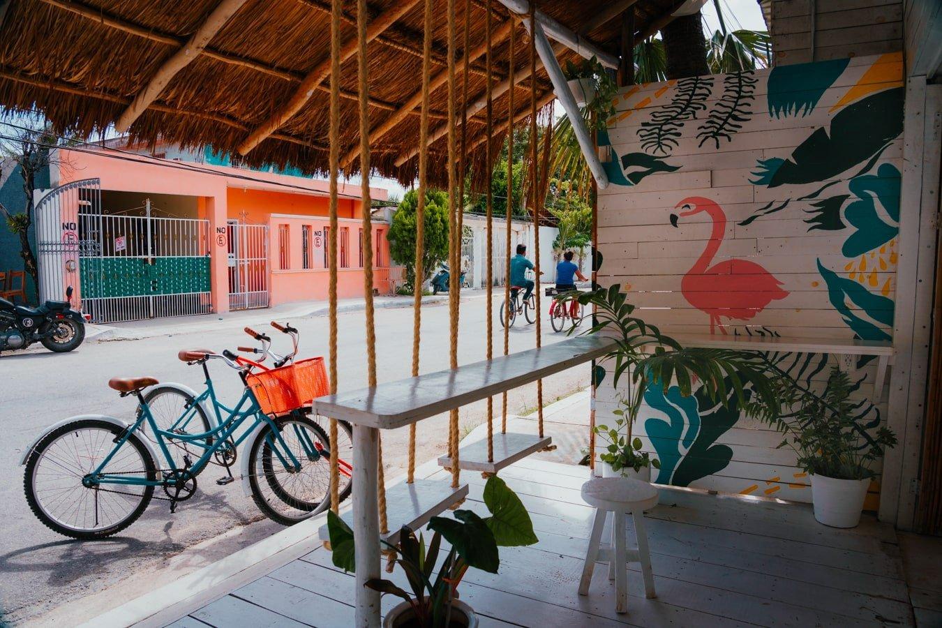 bike rentals in tulum parked in front of matcha mama hut in the pueblo